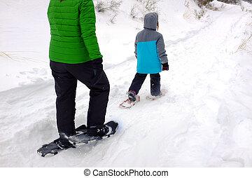 Family Snowshoeing in the Winter Snow kids having fun