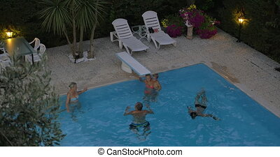 Family spending time in the outdoor pool