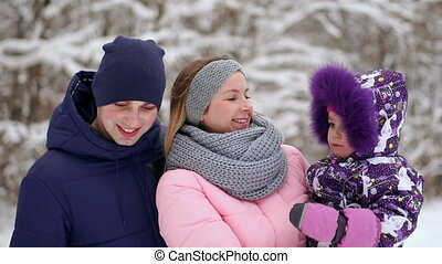 family spends time together in the winter