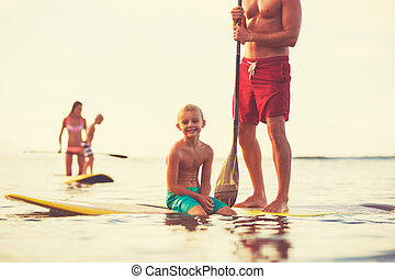 Family Stand Up Paddling - Family stand up paddling at...