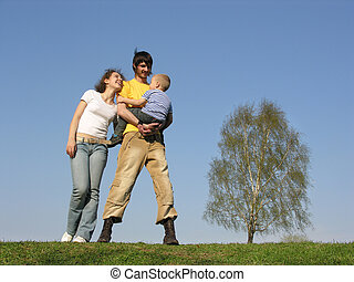 family stand with son. spring