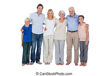 Happy family standing against a white background