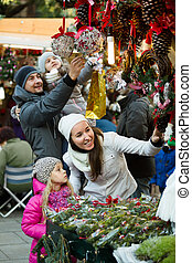 Family standing at coniferous souvenirs counter - Ordinary ...