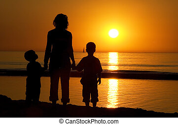 Family Standing At The Beach