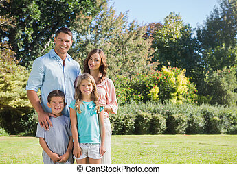 Family standing in a park