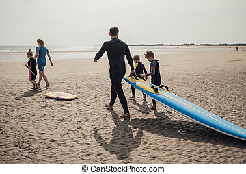 Family Surfing at the Beach