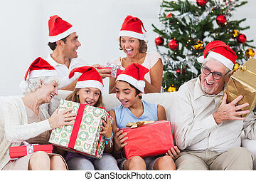 Family swapping christmas presents - Excited family swapping...