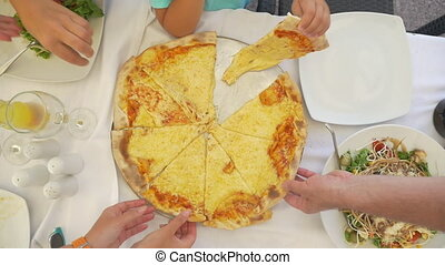 Family taking delicious cheese pizza