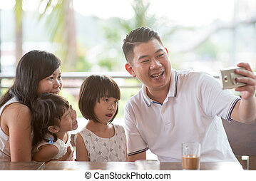 Family taking self photo