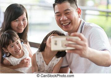 Family taking self photograph
