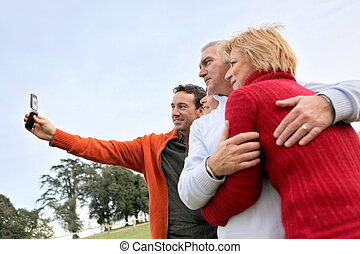 Family taking their own picture with a phone