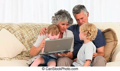 Family talking about the laptop