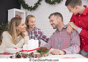 Family talking at Christmas table