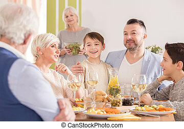 Family talking at the table