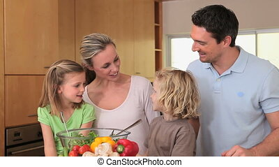 Family talking in the kitchen