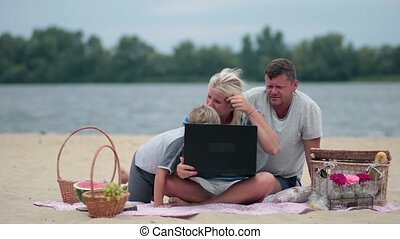 Family talking with grandparents using laptop