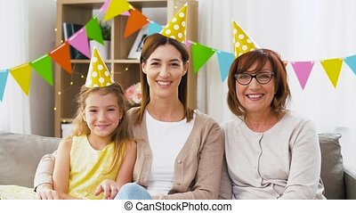 mother, daughter and grandmother at birthday party - family,...