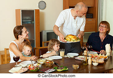 Family together around celebratory table