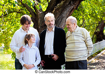 Family together. Grandfather, father and kids.