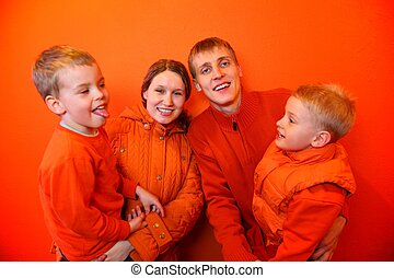 Family together on an orange background