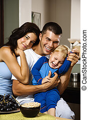 Family together. - Caucasian family with toddler son in...