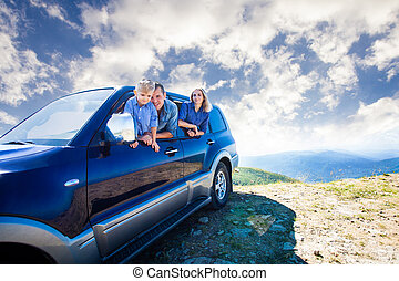 Family travel by car - Happy family, young dad, mom and son,...