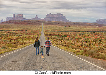 Family travel to Monument Valley and holding hands