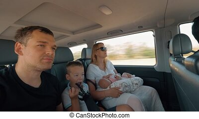 Family traveling by car