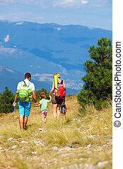 family traveling through the mountains