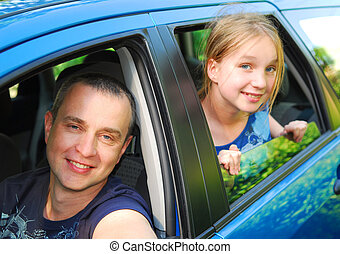 Father and daughter sitting inside the car ready to go on family trip