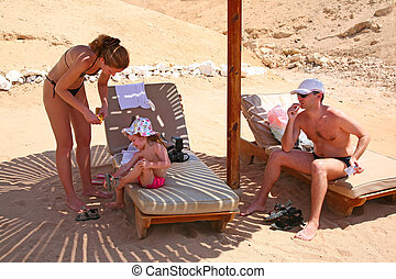 family umbrella beach