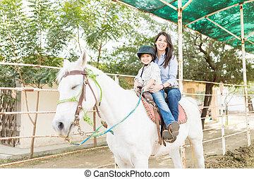 Family Undergoing Equine Therapy Program