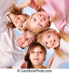 Family union - A young friendly family making circle while ...