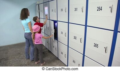 Family use automatic system in storage room and check that...