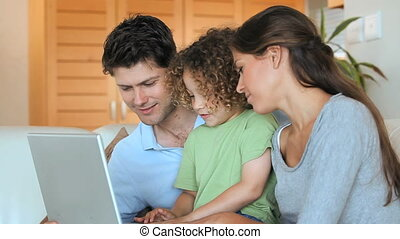 Family using a computer in the living room