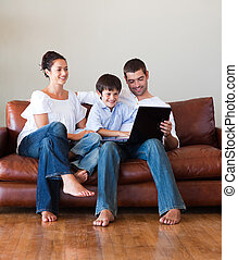 Family using a laptop together