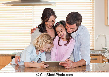 Family using a tablet computer together
