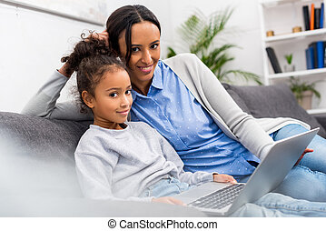 family using laptop at home