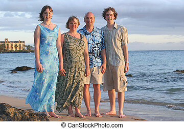Family Vacation - A beautiful,dressed up family with on a...