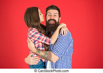 Family values concept. Family bonds. Friendly relations. Father hipster and his daughter. Sweet hug. Man bearded father and cute little girl daughter on red background. Celebrate fathers day