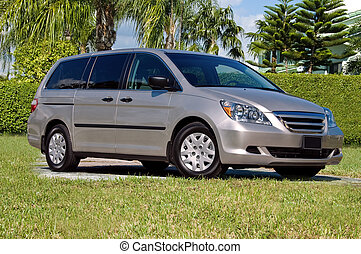 Family Van - front-right shot of a silver minivan