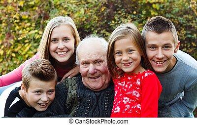 Grandchildren visiting grandfather, giving him a happy moment.