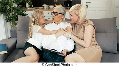 Family Visiting Grandmother - Happy preteen girl and young...