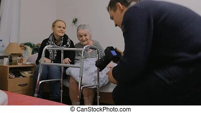 Family visiting grandmother in the hospital