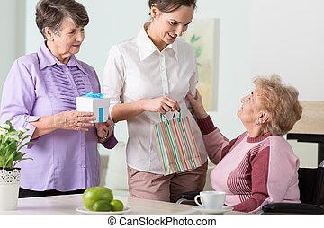 Family visiting woman having birthday