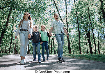 family walk in the city Park.