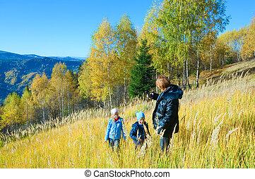 Family walk on autumn  mountain Nimchich pass