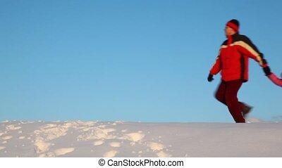 family walk on snow hill