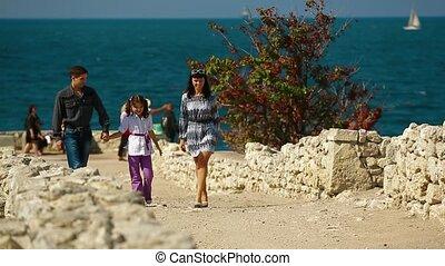Family Walk On The Coast