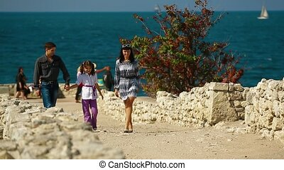 Family Walk On The Coast